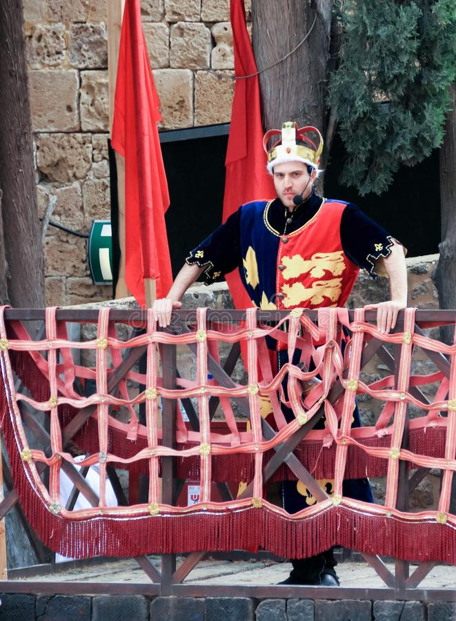 Member of the knight tournament, dressed like King Richard the Lionheart stands on the rostrum on the list in the fortress of the stock photos
