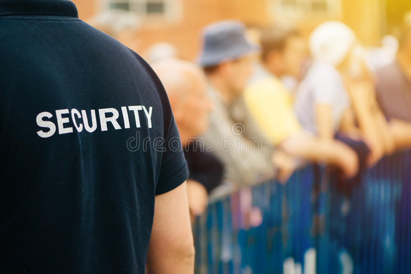 Member of security guard team on public event. Member of security guard team working on public event, unrecognizable male person from behind stock images