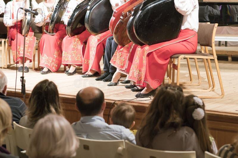 Members of the Bandura ensemble perform Ukrainian folk songs at the Philharmonic. stock images