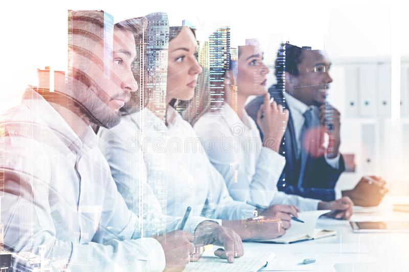 Diverse business team members in a city, HR job stock photo
