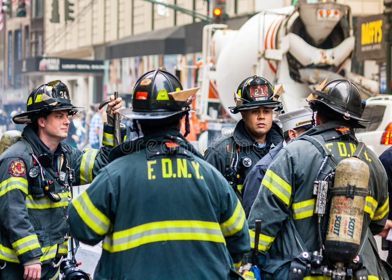 Members of Fire Department New York. Members of the Fire Department New York in discussion about the strategy royalty free stock image