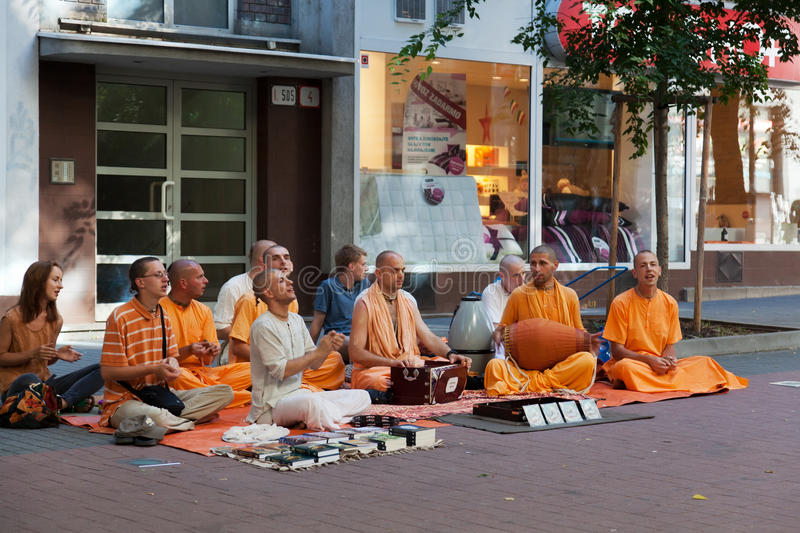 Members of Hare Krishna. Sit and sing on one of the central streets of Bratislava, Slovakia July 22, 2013 stock images