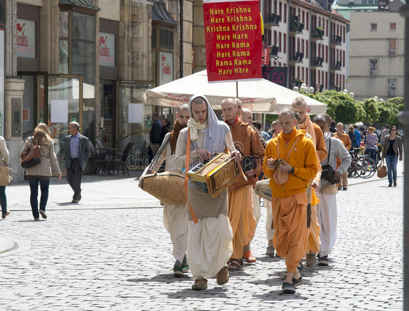 : members of Hare Krishna. Wroclaw, Poland - 18 2014: members of Hare Krishna chanting and dancing May 18, 2014 on Wroclaw in Poland royalty free stock images