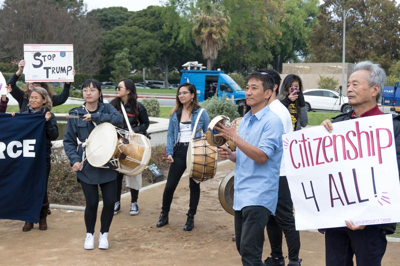 Members of the Korean Resource Center at the Defend Dreamers Rally. BEVERLY HILLS, CALIFORNIA - MARCH 12, 2018: Members of the Korean Resource Center at the royalty free stock images