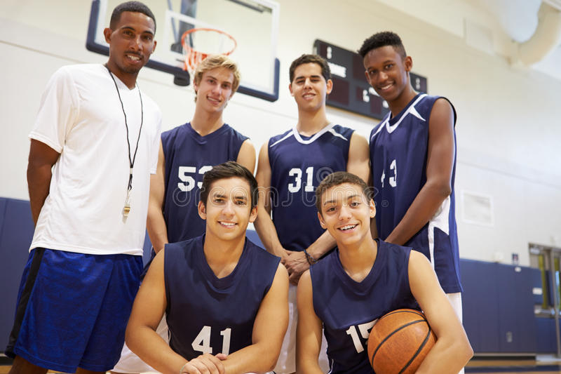 Members Of Male High School Basketball Team With Coach stock images
