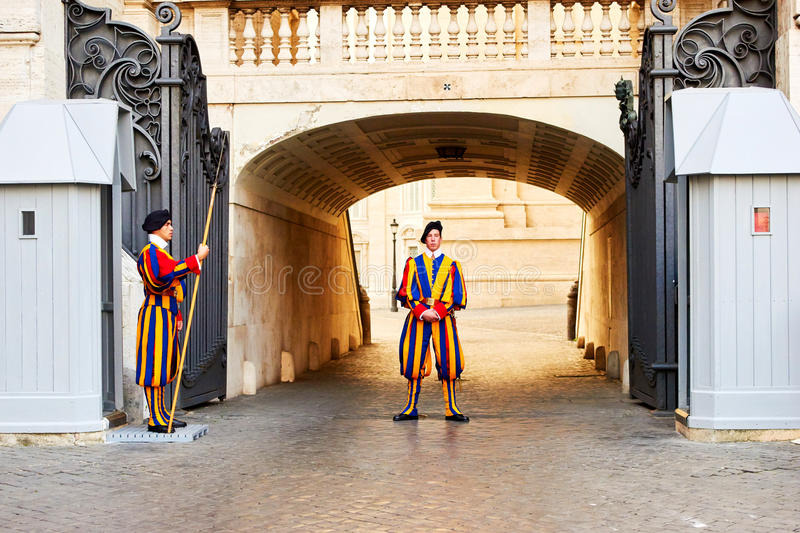 Members of the Pontifical Swiss Guard protect entrance to Vatican. VATICAN CITY, VATICAN - OCTOBER 29: Members of the Pontifical Swiss Guard protect entrance to royalty free stock images