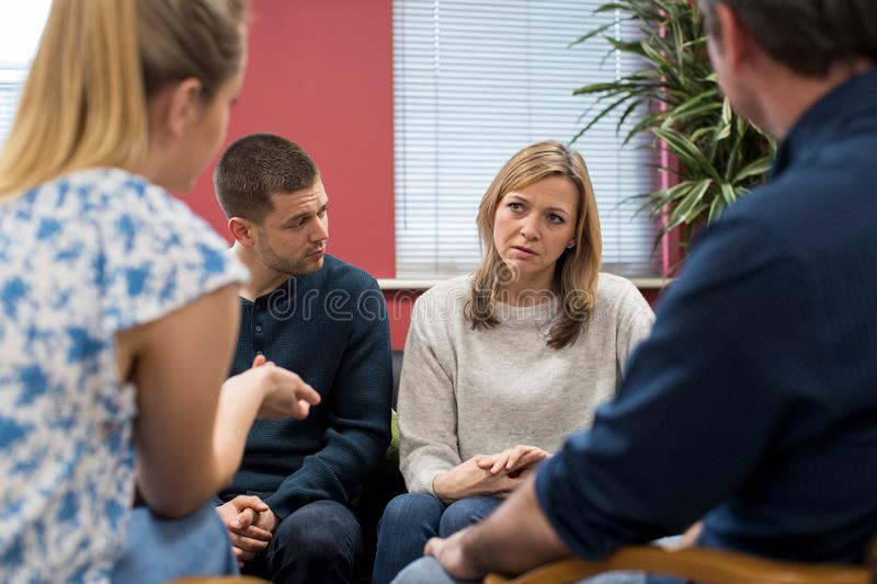 Members Of Support Group Sitting In Chairs Having Meeting. Together royalty free stock photo