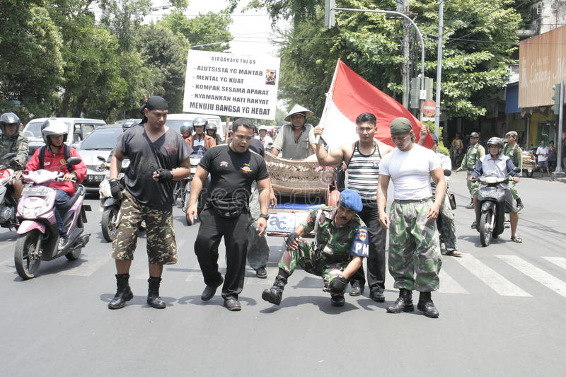 Members theatrical action Army Indonesia. Action Cpl Bagyo runs with squatting as a symbol of a strong army for the people of Indonesia royalty free stock photos