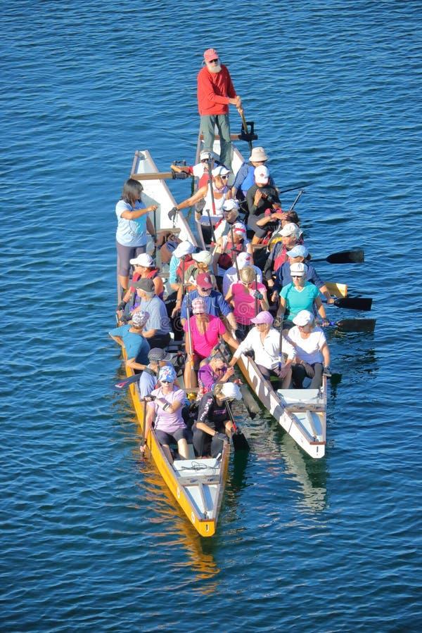 Membres du club d'aviron de False Creek photo stock