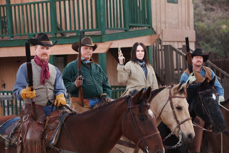 Membri del comitato di vigilanza occidentali su a cavallo fotografie stock libere da diritti