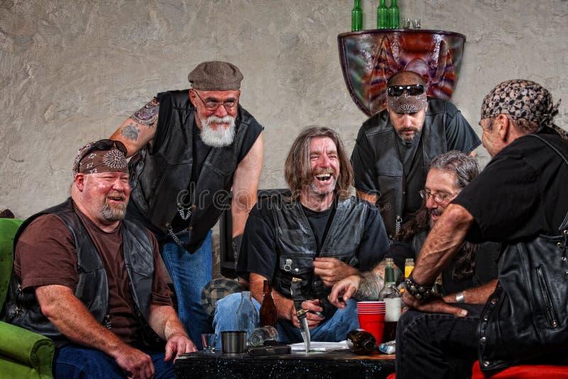 Membri di risata del gruppo fotografie stock libere da diritti