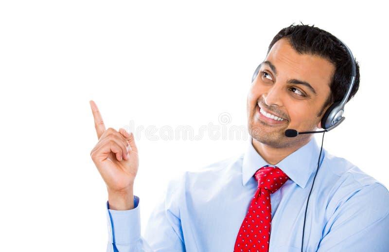 Membro masculino do apoio ao cliente que aponta em um espaço da cópia foto de stock royalty free