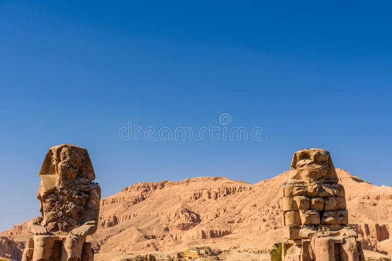 Memnon colossi statues of the Pharaoh Amenhotep III in Luxor, Egypt stock images