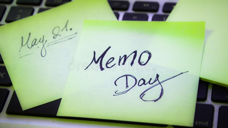 Memo day. Sticky note on keyboard, Memo day, May 21 royalty free stock photos