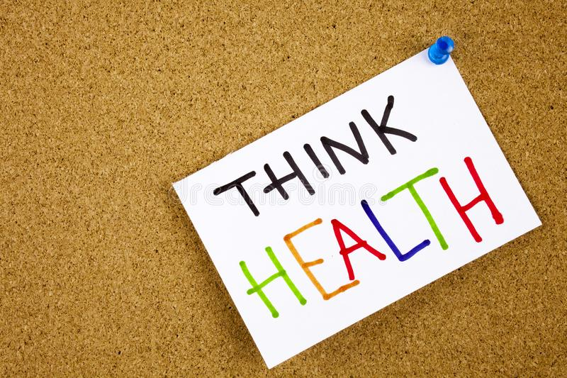 Memo note pinned to a cork notice board as reminder Think Health. Memo note on pinned to a cork notice board as reminder Think Health Concept stock images