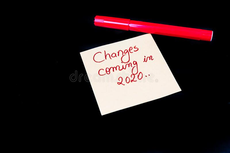 .Memo post reminder with text Changes coming in 2020 and red marker isolated on black background. Memo post reminder with text Changes coming in 2020 and red royalty free stock images