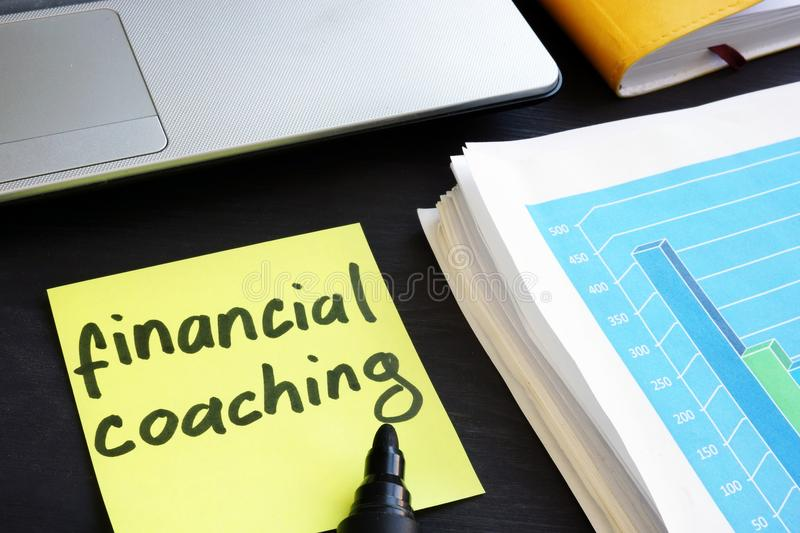 Memo stick with words financial coaching. Education. royalty free stock photos