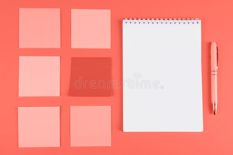 Memo stickers and notebook on orange background royalty free stock photos