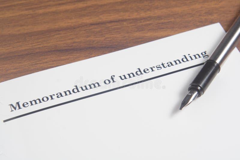 Memorandum of Understanding Letter. At wooden table stock photography