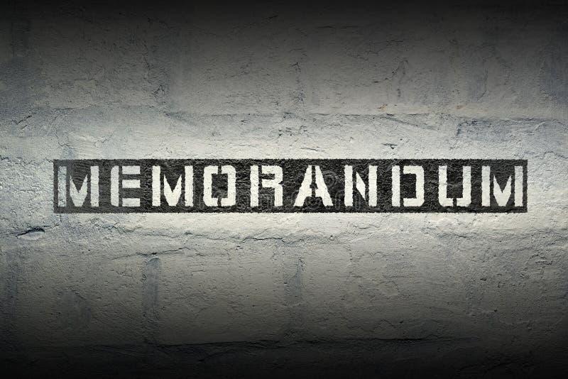 Memorandum WORD GR. Memorandum stencil print on the grunge white brick wall stock photo