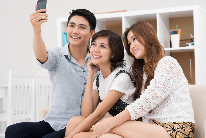 Memorative photo. Youngsters taking photo of themselves inside royalty free stock photography