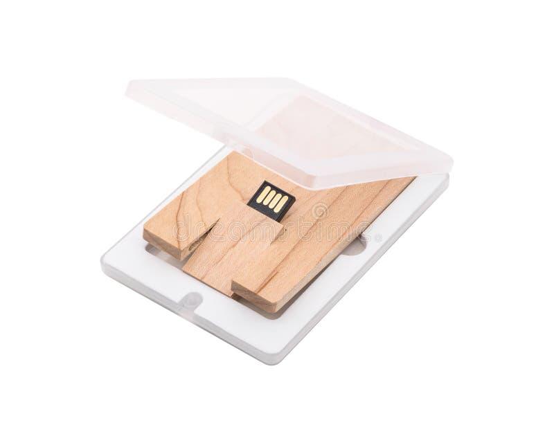 Memoria USB de madera aislada en el fondo blanco Palillo del USB hecho del material de madera en paquete del pl?stico transparent imagenes de archivo