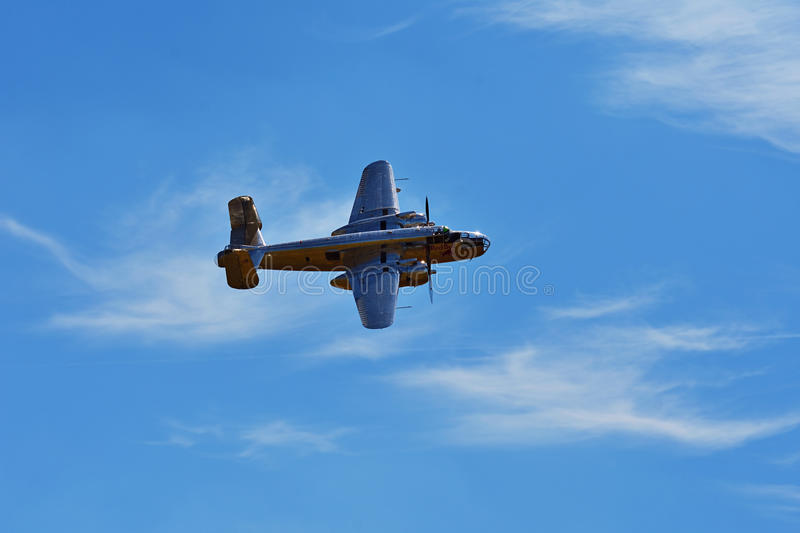 Memorial Airshow. Chrome B-25 Mitchell bomber plane from World War II in flight. royalty free stock images
