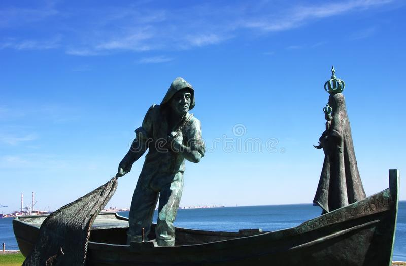 bronze statues of fishermen and Our Lady stock photos