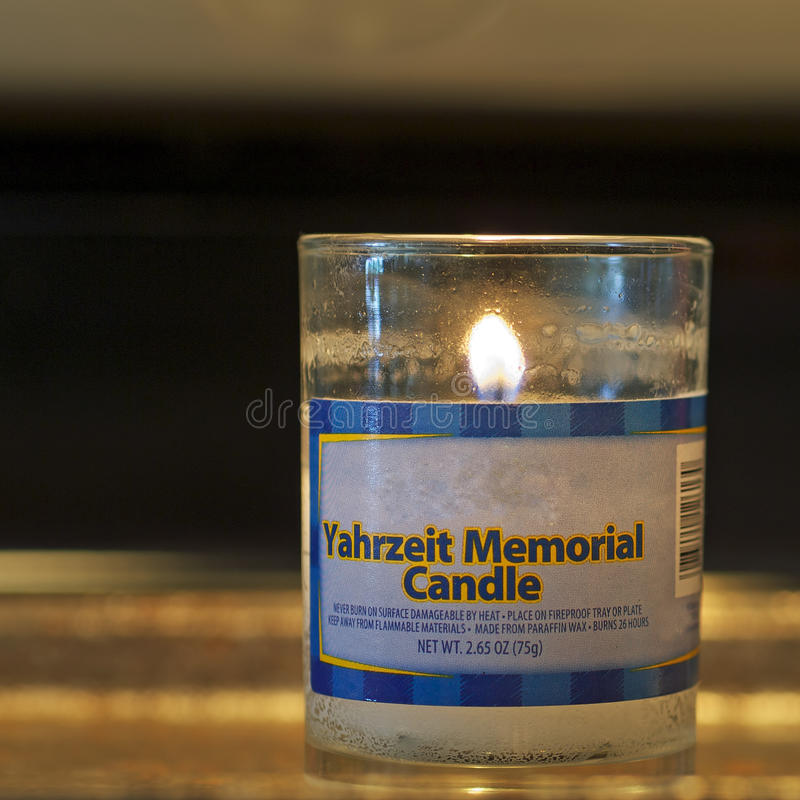 Memorial candle square. This yahrzeit memorial candle is burned to remember dead relatives on the anniversary of their deaths as part of the Jewish traditions royalty free stock photos