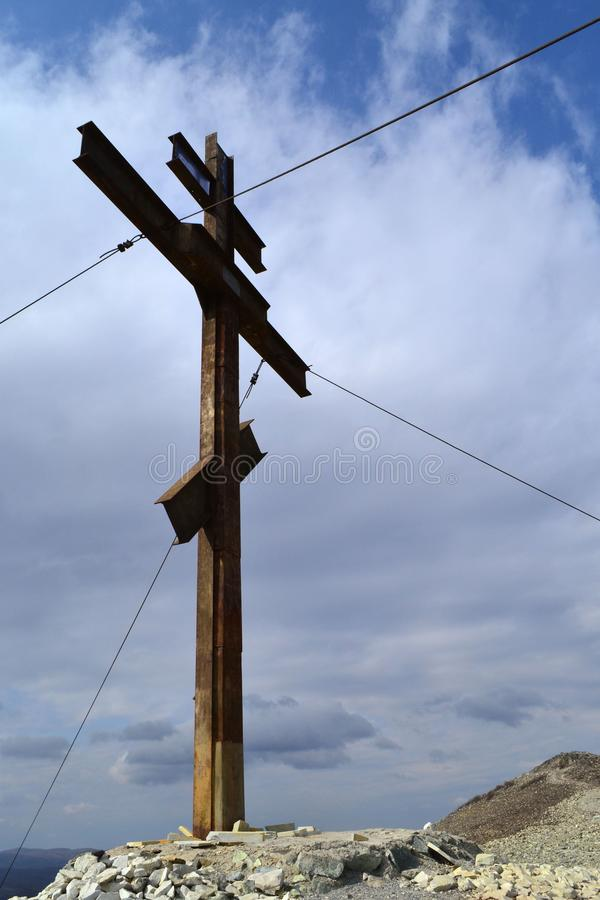 Memorial cross on the mountain. Karabash, zone of ecological disaster. Russia. Clouds, sky, dramatic, religion stock photos