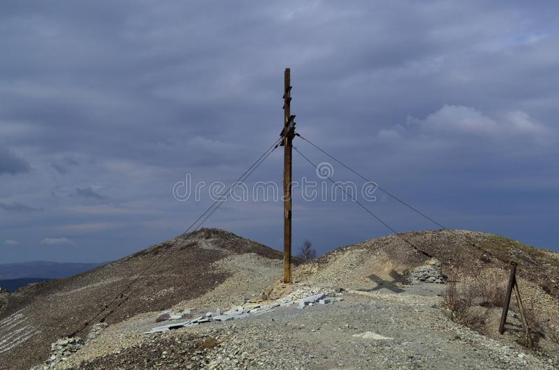 Memorial cross on the mountain. Karabash, zone of ecological disaster. Russia. Dramatic, sky, religion stock photos