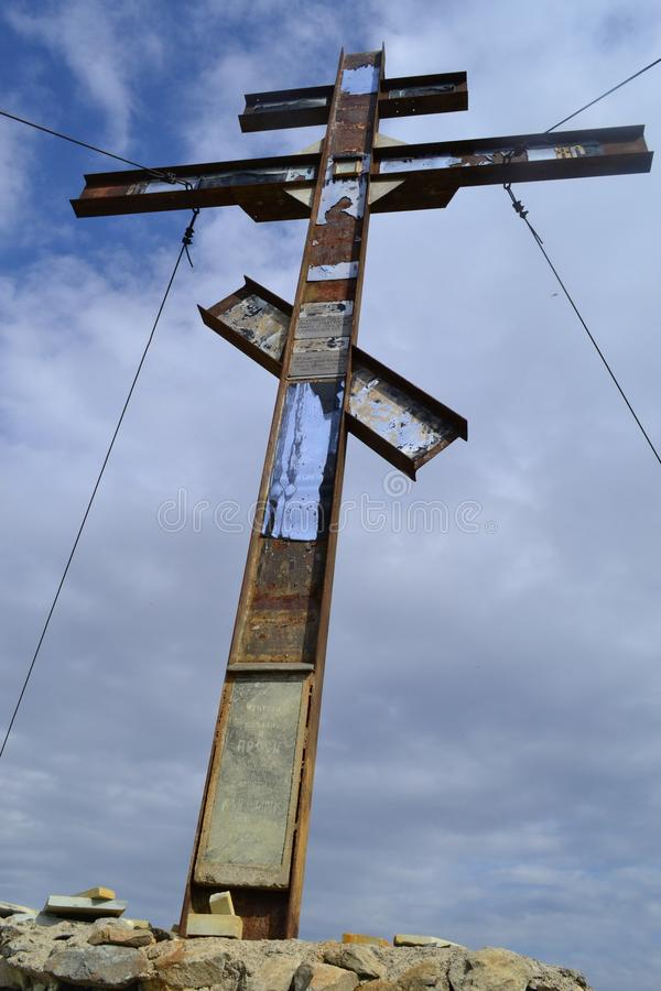 Memorial cross on the mountain. Karabash, zone of ecological disaster. Russia. Religion, dramatic, sky, clouds, cloudy stock photography