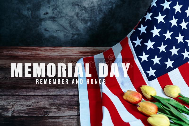 Memorial Day with American flag and flower on wooden background royalty free stock image