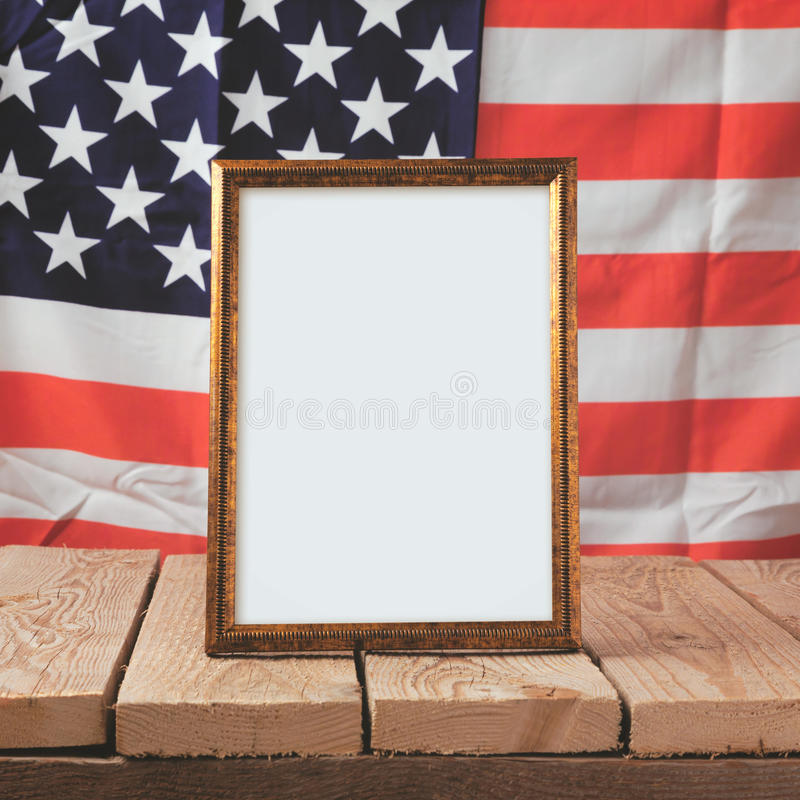 Memorial day background. Picture frame over USA flag stock photography