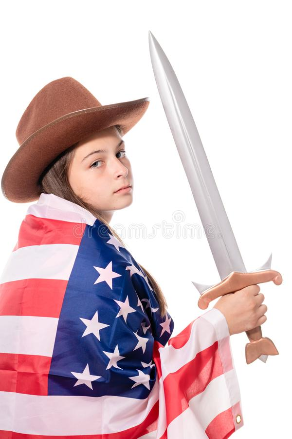 Attractive girl with american flag and sword stock photography