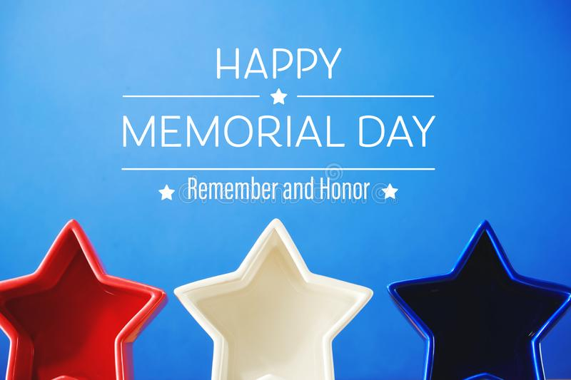 Memorial day message. With red white and blue star decorations stock photos