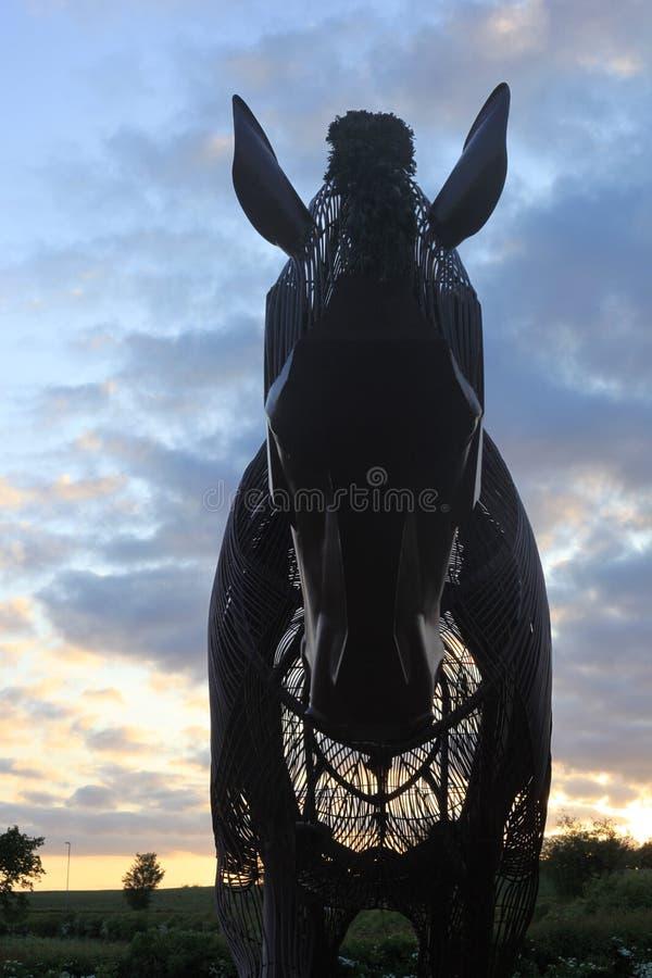 Memorial do cavalo de guerra no por do sol fotos de stock royalty free