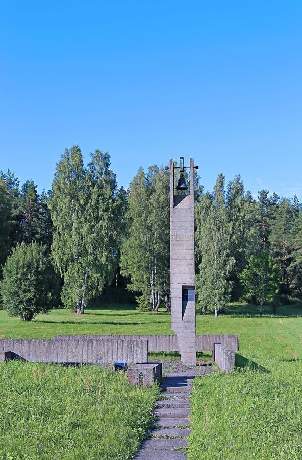 Memorial funeral bells in Khatyn. Against the blue sky stock photos