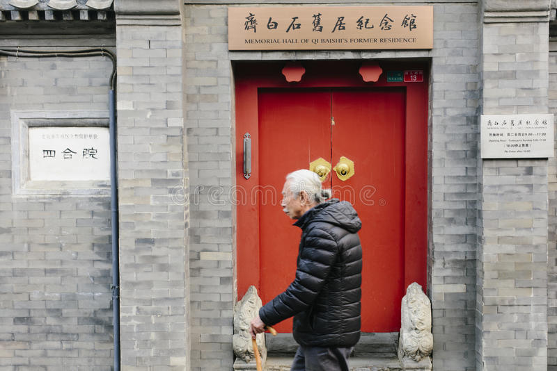Memorial Hall of Qi Baishi`s Former Residence. An old man walked passed the Memorial Hall of Qi Baishi`s Former Residence in Beijing,China royalty free stock photo
