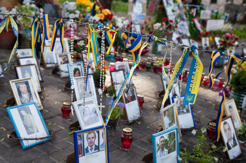 Memorial on the Instytutska str., Kyiv, Ukraine. KIEV, UKRAINE - May 23, 2014: spontaneously built a memorial to those killed by the bullets of snipers on the royalty free stock image