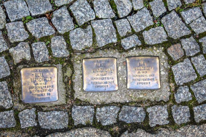 Memorial of jews deported and exterminated in the holocaust on a street in Berlin. Stolpersteine literally, stumbling stones, set into the pavement in Berlin royalty free stock photo