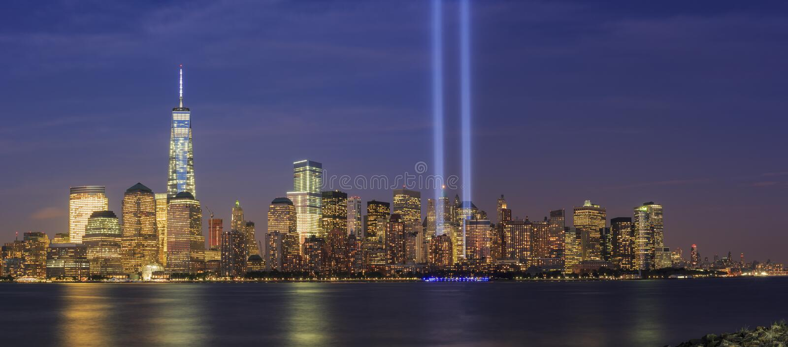 911 Memorial light and New York City skyline. At night royalty free stock images