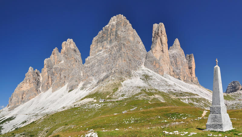 Memorial monument in Dolomites mountains stock images