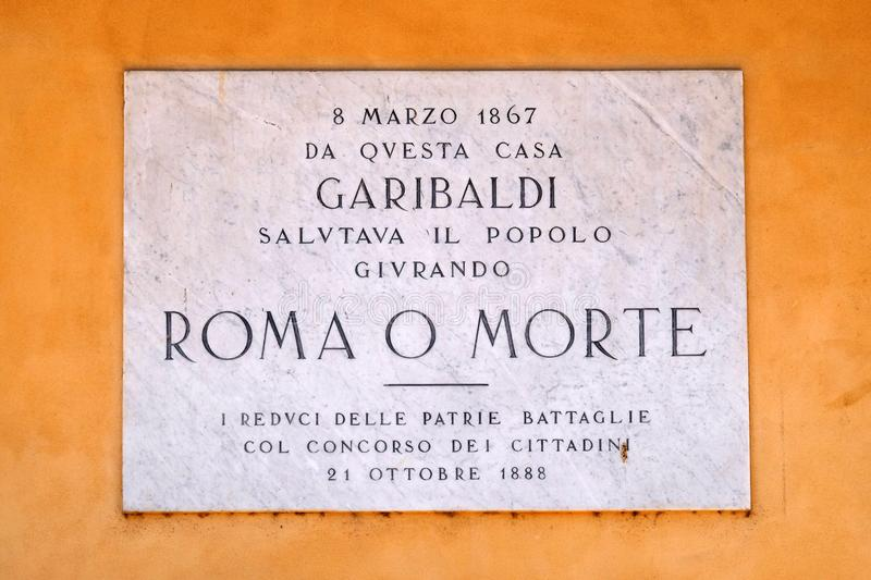 A memorial panel devoted to Italian general, politician and nationalist Giuseppe Garibaldi on the facade on Piazza Bra in Verona stock images