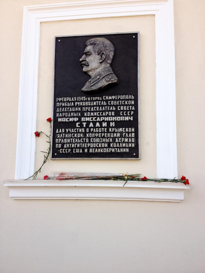Memorial plaque in honor of Stalin in Simferopol. SIMFEROPOL, CRIMEA, UKRAINE - FEB 28, 2017: Memorial plaque in honor of Stalin on main office of Communist royalty free stock photos