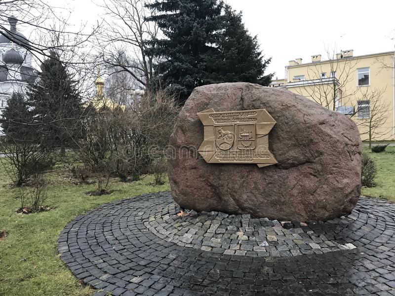 Memorial plaque on a stone on the boulevard Heinola. On the stone is fixed a metal tablet with the arms of the two cities - Barano. Vichi and Heinol. Baranovichi stock image
