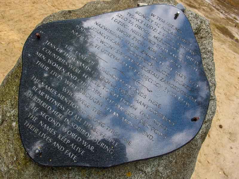 Memorial Plate aboud uprising in Sobibor nazi extermination camp in 1943. Plae and stone iare located ion the terrain of the Sobibór Nazi German stock photography