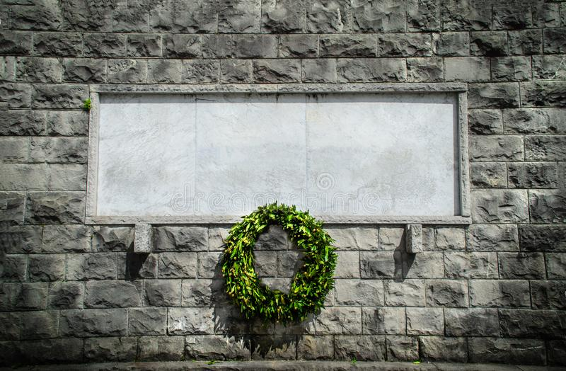 Memorial stone blank funeral crown background. Black and white stock image