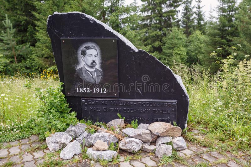 Memorial stone to the famouse Russian writer Mamin Sibiryak. Village Visim, Russia. Memorial stone to the famouse Russian writer Mamin Sibiryak on top of the stock photography