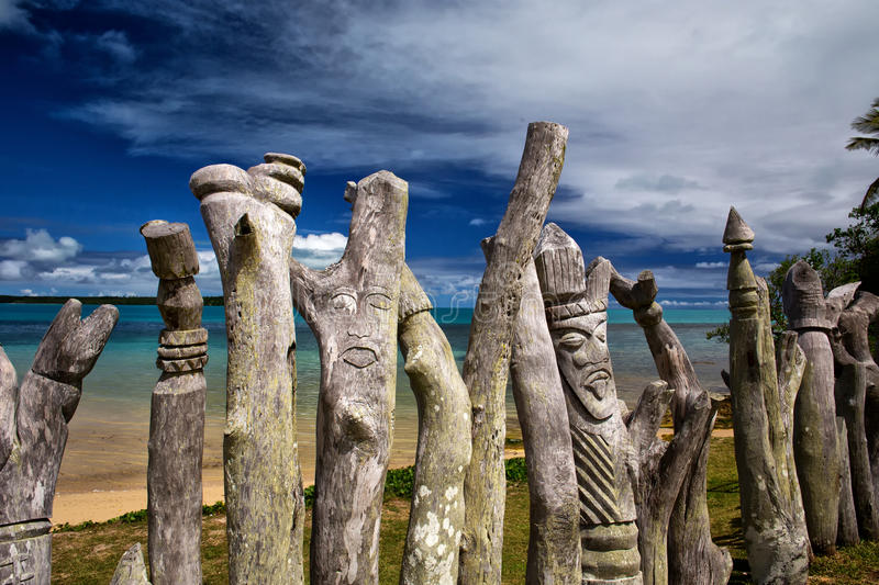 Memorial to Christian missionaries. Detail from a memorial to European Missionaries on Isle Of Pines - carved totems stock photo